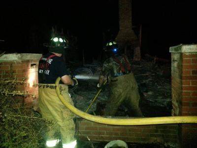 Couple's 100 year old house catches fire