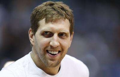Nowitzki signs two-year deal with Mavericks, gets bump to $50 million