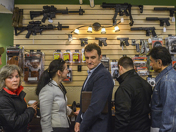 Virginia gun shop opens; demonstrators stage rally nearby