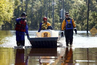 North Carolina governor pledges aid to flooded historic town