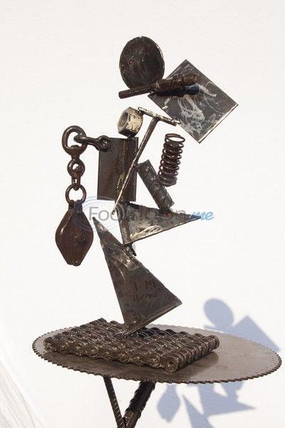 Former junk picker turns salvaged metal into furniture, art