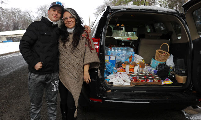Mother and son help out homeless after snow strikes