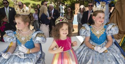 Visitors to Tyler line up by the hundreds to meet Texas Rose Festival royalty at Queen's Tea