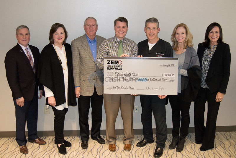 Prostate cancer run/walk group gifts Bethesda Health Clinic