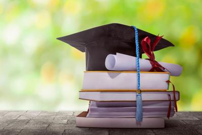 stock_school_books_graduation_diploma_cap