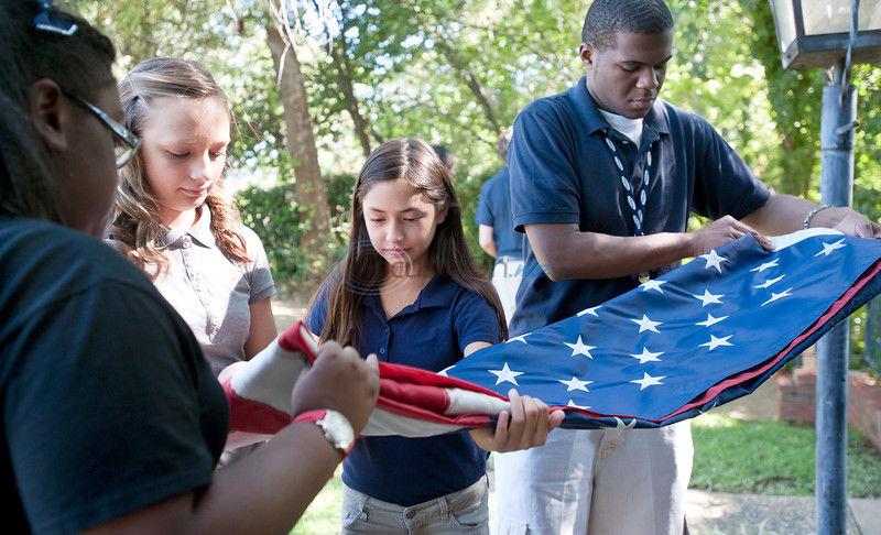 Hogg students learning flag-raising