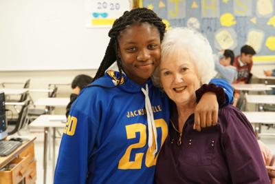 A beloved Jacksonville teacher is back in the class thanks to a quick-thinking student