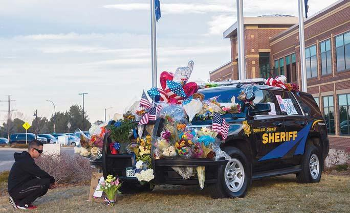 Colorado shooter was lawyer, Iraq war veteran
