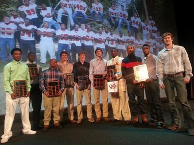 Honor squad: Lee announces awards at annual football banquet