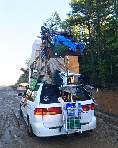 Driver ticketed for strapping furniture, bicycles to roof