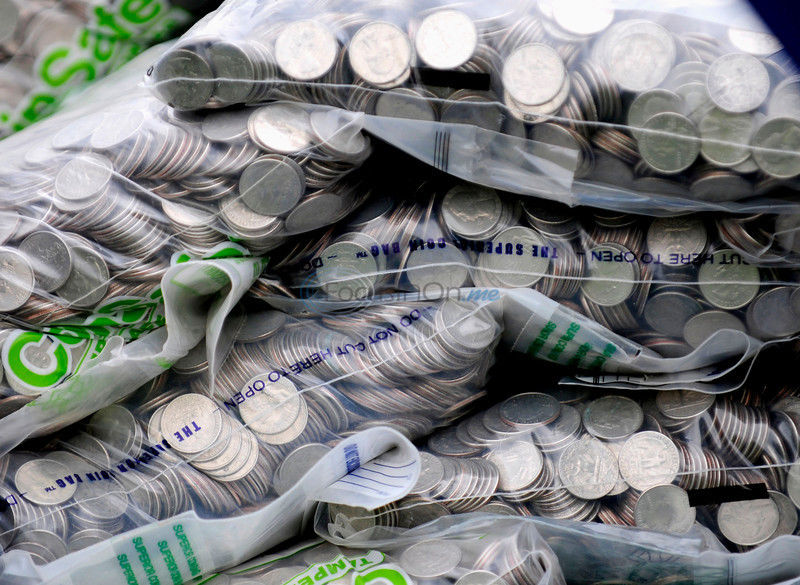Man repays insurance legal settlement with 4 tons of coins
