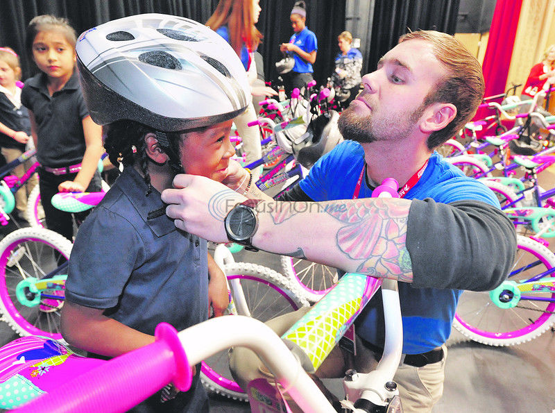 Thirty Birdwell Elementary School students surprised with early Christmas presents of new bikes