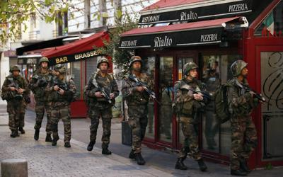 2 dead, 7 arrested in raid targeting Paris attack mastermind; woman detonates suicide vest