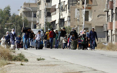 UN: Fighting displaces 100,000 in central Syria in 8 days