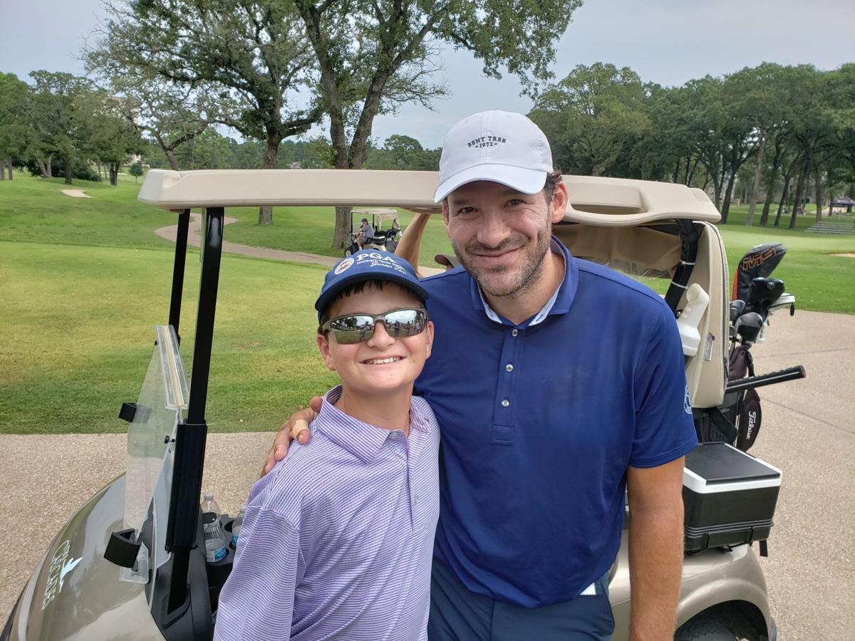 Tony Romo with Jaxson Green