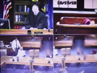 Video shows agitated Michigan judge tear off robe, tackle man in courtroom
