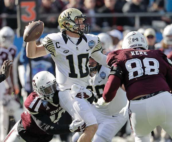 Wake Forest QB throws for 4 TDs, 400 yards to beat Texas A&M 55-52