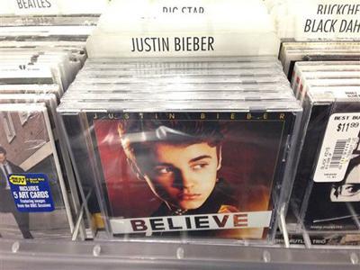 Artist plants fake Bieber CDs in LA stores