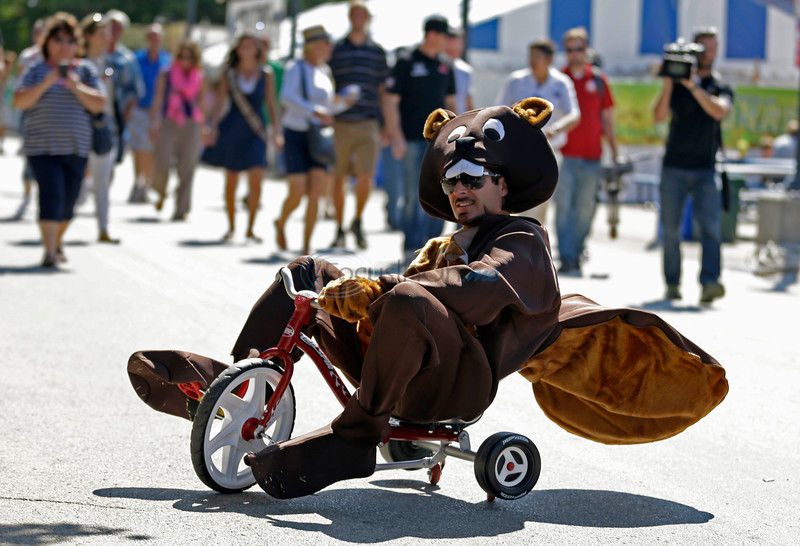 Indy driver Tagliani pays off wager with beaver-suit stunts