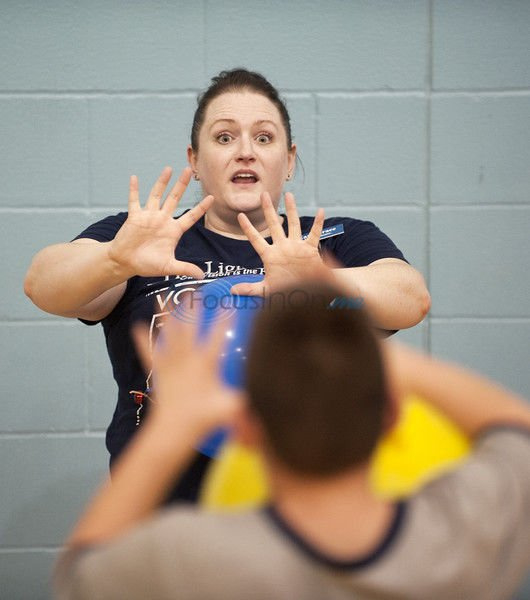 Students learn to play ball despite visual impairments