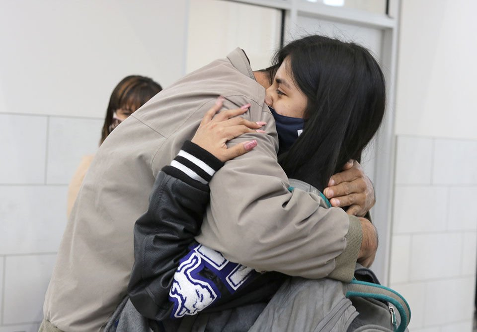 Tyler High student Adriana Higuera hugs her father after finding out about scholarship award
