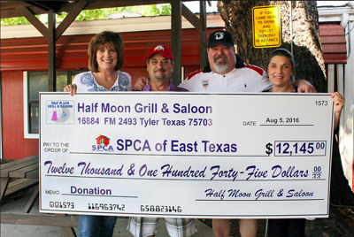 SPCA of East Texas receives donation from Half Moon Grill