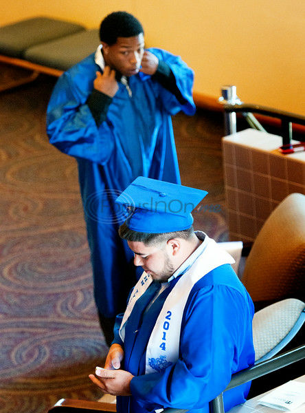 Summer graduates walk the stage with diploma