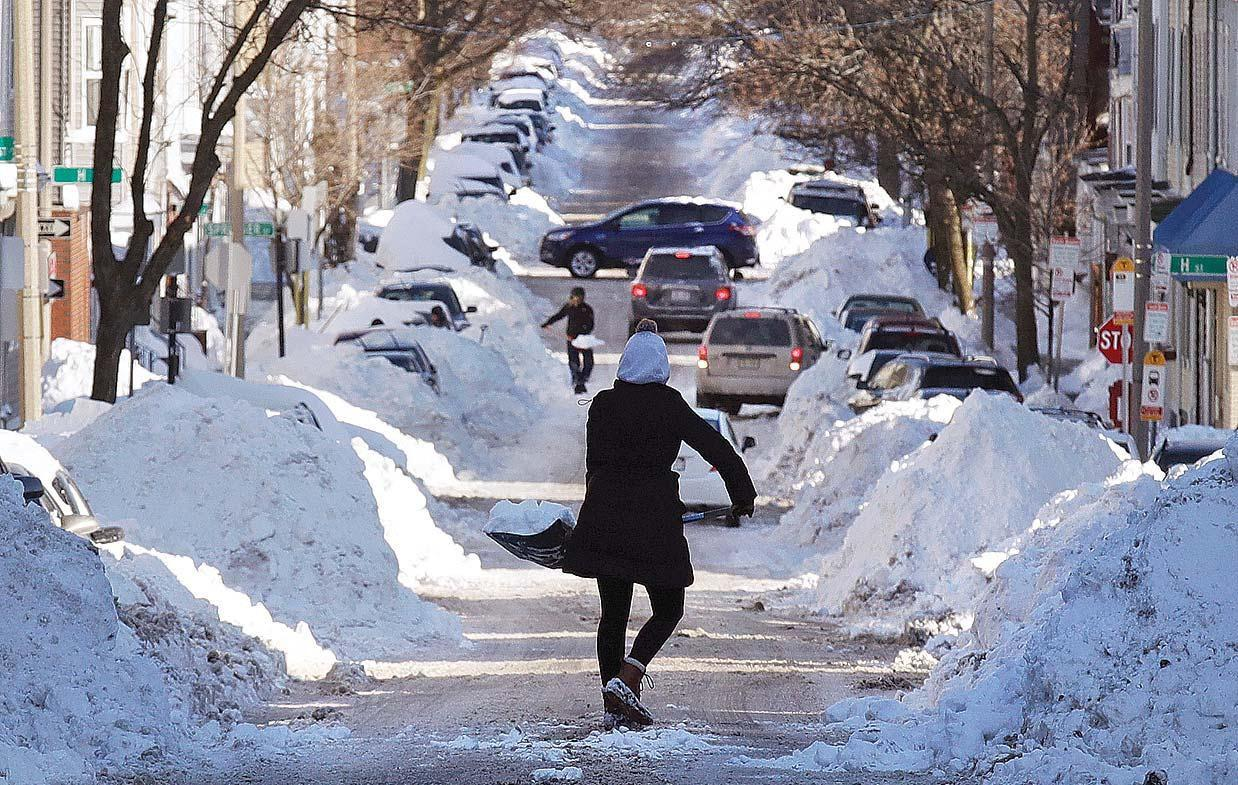 East Coast digs out from storm, but cold lingers