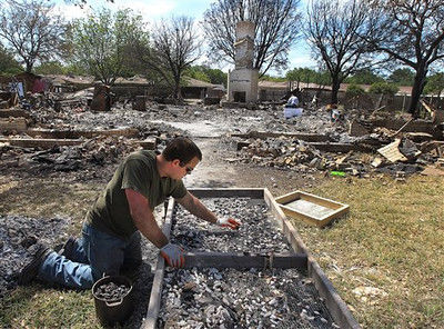 Homes starting to be razed in blast-damaged West