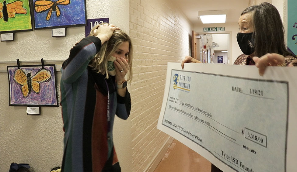 Caldwell Arts Academy Counselor gets surprised when grant is presented