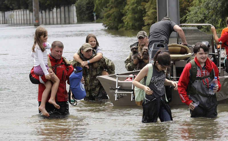 Trump praises spirit of Texans as they cope with Harvey