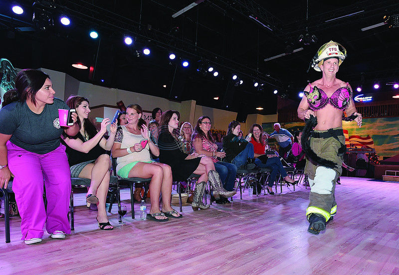 Firefighters get fashionable for breast cancer fundraiser