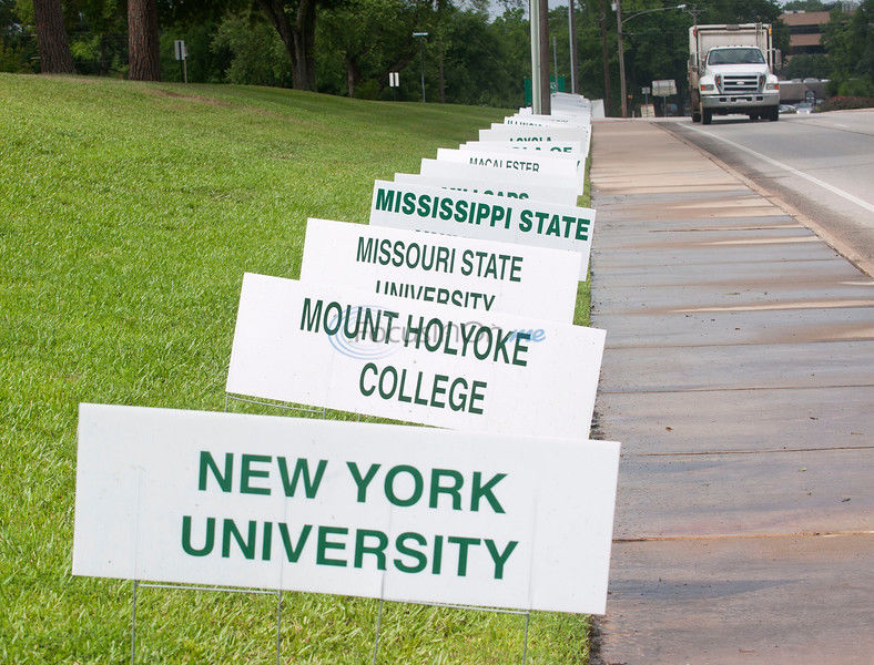 Gorman displays signs for graduates