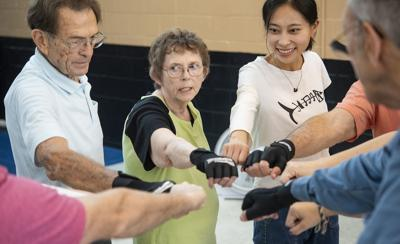 UT Tyler nursing students learn about Parkinson's disease by assisting with boxing program