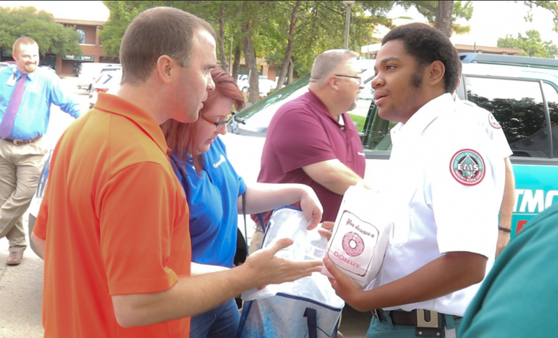 Genesis Group thanks public safety workers by passing out breakfast across town