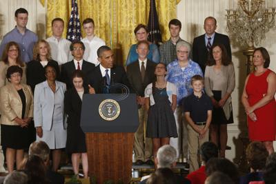 Obama talks up health care law's rebates