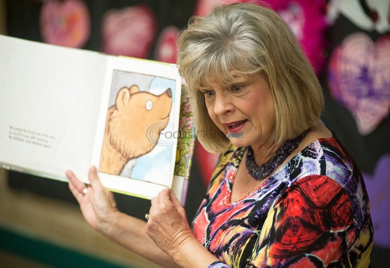 YES! Story - Book Club: 'Book Buddy' volunteers bring library to kids
