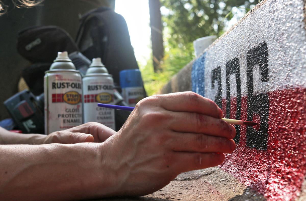 Wills Point native brings art to Tyler by painting homeowners' curb address numbers