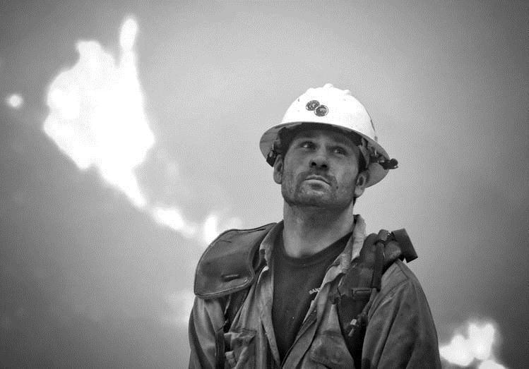 Crews struggle to keep flames from California neighborhoods