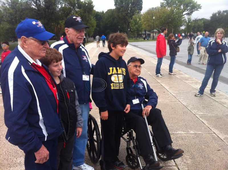 World War II veterans return home from Heroes Flight