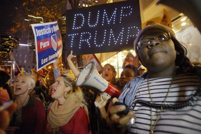 Donald Trump hosts 'SNL,' with mock heckler inside and real protesters outside