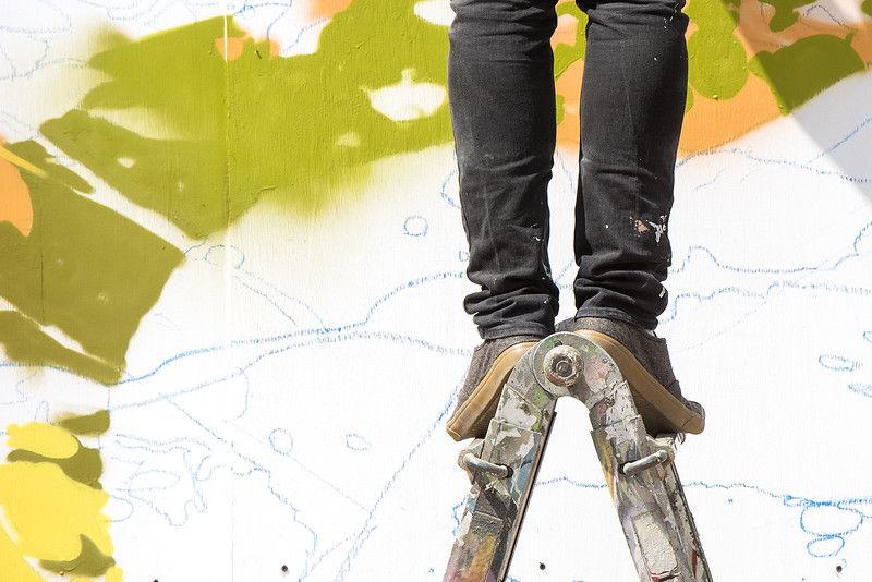 Artist live paints rainforest-themed murals each day of the East Texas State Fair
