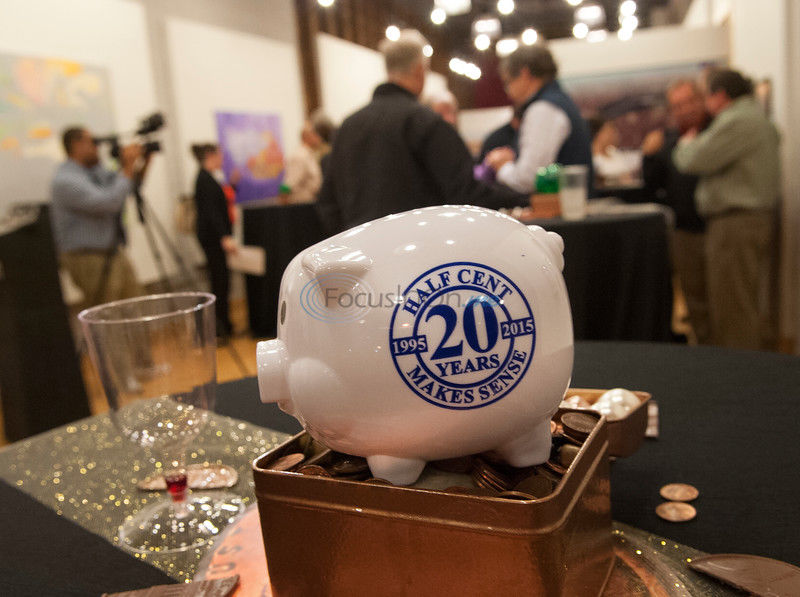 Party celebrates 20 years of half-cent tax