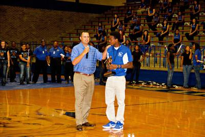 Top-ranked John Tyler falls on the road