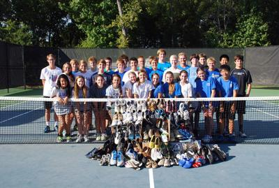All Saints tennis players donate 140 pairs of shoes