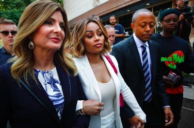 Blac Chyna says Rob Kardashian hit her; restraining order put into place
