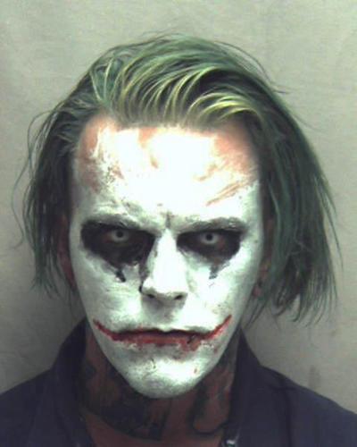 Man carrying a sword, dressed as Joker arrested