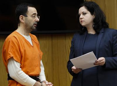 Michigan sports doctor pleads guilty to assaulting gymnasts
