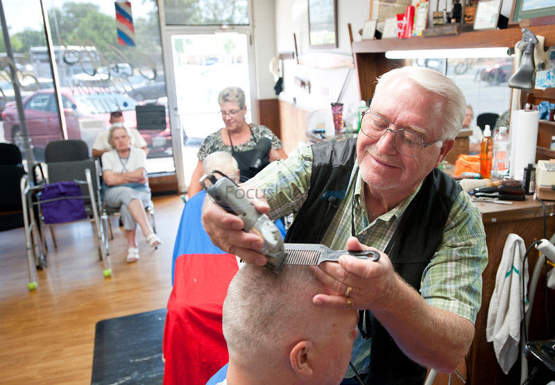 After 52 years, barber keeps cutting, singing