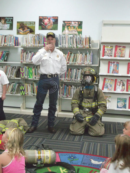 Gear Fear: Children unveil the person beneath a firefighter's uniform